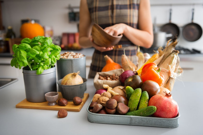 Selection of Autumn fruits and vegetables on kitchen counter